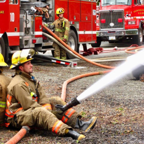 Firefighter on Fire Hose